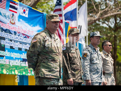 RAYONG PROVINCE, Thailand (Feb. 21, 2017) – (From left to right) Brig. Gen. Bryan Suntheimer, United States Army Pacific Deputy Commanding General for Army National Guard, Rear Adm. Jong Sam Kim, commander, Republic of Korea Navy Component 5, Vice Adm. Panya Lekbua, deputy commander-in-chief, Royal Thai Fleet and Gov. Surasak Charoensirichot, Rayong provincial governor stand on stage during a dedication ceremony, marking the completion of the Ban Nong Muang school expansion project. The project was a joint effort by the U.S. Naval Mobile Construction Battalion 5, Construction and Developmental - Stock Photo