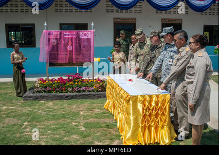 RAYONG PROVINCE, Thailand (Feb. 21, 2017) – Brig. Gen. Bryan Suntheimer, United States Army Pacific Deputy Commanding General for Army National Guard, Rear Adm. Jong Sam Kim, commander, Republic of Korea Navy Component 5, Vice Adm. Panya Lekbua, deputy commander-in-chief, Royal Thai Fleet and Gov. Surasak Charoensirichot, Rayong provincial governor, along with Rayong province school officials, ring the school bells, officially marking the completion of the Ban Nong Muang school expansion project. The project was a joint effort by the U.S. Naval Mobile Construction Battalion 5, Construction and - Stock Photo