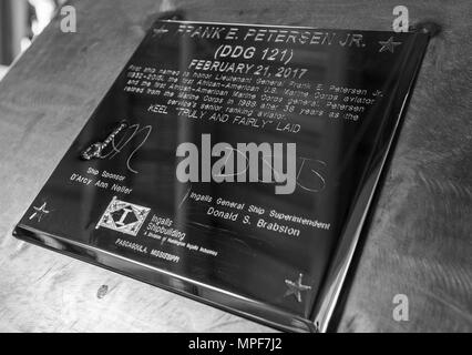 A plaque is displayed during the keel laying ceremony for Frank E. Petersen, Jr. DDG 121, at Ingalls Shipbuilding, Pascagoula, Miss., Feb. 21, 2017. D'Arcy Neller, wife of Commandant of the Marine Corps Gen. Robert B. Neller, was the ship's sponsor for the ceremony. (U.S. Marine Corps photo by Cpl. Samantha K. Braun) - Stock Photo