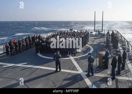 170217-N-JI086-041 MEDITERRANEAN SEA (Feb. 17, 2017) Cmdr. Andria Slough, commanding officer of the guided-missile destroyer USS Porter (DDG 78), addresses Sailors during an all-hands call. Porter is forward-deployed to Rota, Spain, conducting naval operations in the U.S. 6th Fleet area of operations in support of U.S. national security interests in Europe. (U.S. Navy photo by Mass Communication Specialist 3rd Class Ford Williams/Released) - Stock Photo