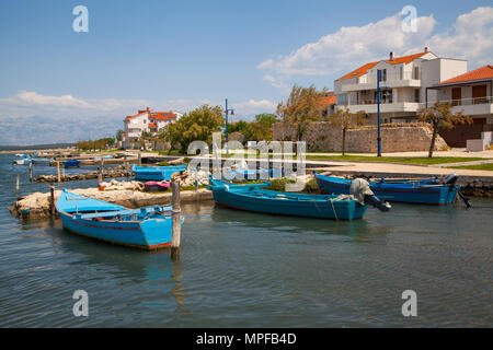Small fishing boats in the harbour at medieval walled  town of Nin near Zadar Croatia on the Adriatic coast - Stock Photo