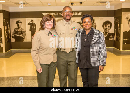 From left, U.S. Marine Corps Col. Cheryl Blackstone, deputy director, G-10 Force Preservation; Col. David D. Scott, real estate analysis, Marine Corps Installations Command and Deanna Scott pose for a photo after Scott's promotion ceremony at the Pentagon, Arlington, Va. on Feb. 17, 2017. Scott was promoted from the rank of Lt. Col. to Col. (U.S. Marine Corps photo by Lance Cpl. Paul A. Ochoa) - Stock Photo