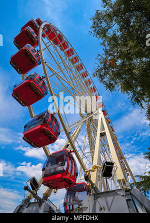 Ferris wheel in Geneva Geneve of Switzerland Swiss - Stock Photo