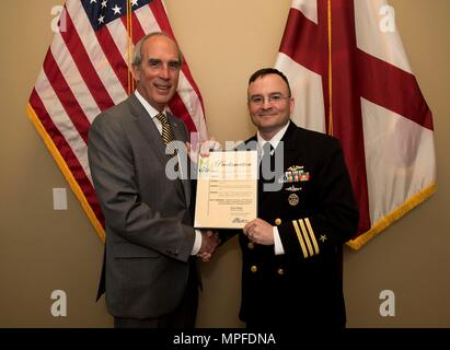 170223-N-MJ645-185 MOBILE, Ala. – (Feb. 23, 2017) Mobile Mayor Sandy Stimpson presents Cmdr. Paul Reinhardt, commanding officer of USS Alabama (SSBN 731), with a proclamation designating the Feb. 22 through Feb. 28 as Navy Week in the City of Mobile. Navy Week program serves as the Navy's principal outreach effort in areas of the country without a significant Navy presence. (U.S. Navy photo by Mass Communication Specialist 1st Class Marcus L. Stanley/Released) - Stock Photo