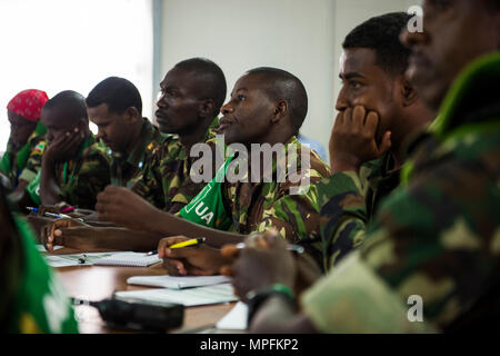 African Union Mission in Somalia (AMISOM) and Somali National Army (SNA) attend the Public Information Officers (PIO) workshop in Mogadishu, Somalia, March 1, 2017. AMISOM and SNA sector PIO's received social media, public affairs operations and effective communication training at the Joint Military Training Center during a three-day workshop. The information operation workshop was facilitated by AMISOM as part of continued efforts to counter and neutralize violent extremists in Somalia and the region. (U.S. Air Force photo by Senior Airman Natalie F. Plas) - Stock Photo