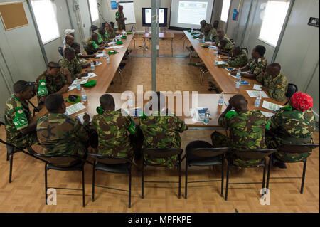 African Union Mission in Somalia (AMISOM) and Somali National Army (SNA) personnel attend the Public Information Officers (PIO) Workshop in Mogadishu, Somalia, March 1, 2017. AMISOM and SNA sector PIO's received social media, public affairs operations and effective communication training at the Joint Military Training Center during a three-day workshop. The information operation workshop was facilitated by AMISOM as part of continued efforts to counter and neutralize violent extremists in Somalia and the region. (U.S. Air Force photo by Senior Airman Natalie F. Plas) - Stock Photo