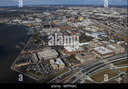 "170302-N-AG722-057 WASHINGTON (March 2, 2017) An aerial view of Naval Support Activity (NSA) Washington on the historic Washington Navy Yard (WNY). The Navy base is the ""Quarterdeck of the Navy"" and serves as the Headquarters for Naval District Washington, where it houses numerous support activities for the fleet and aviation communities. (U.S. Navy photo by Mass Communication Specialist 1st Class John Belanger/Released) - Stock Photo"
