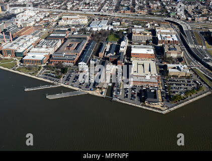 "170302-N-AG722-014  WASHINGTON (March 2, 2017) An aerial view of Naval Support Activity (NSA) Washington on the historic Washington Navy Yard (WNY). The Navy base is the ""Quarterdeck of the Navy"" and serves as the Headquarters for Naval District Washington, where it houses numerous support activities for the fleet and aviation communities. (U.S. Navy photo by Mass Communication Specialist 1st Class John Belanger/Released) - Stock Photo"