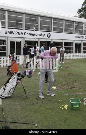 Wentworth, Surrey, UK., 23rd May, 2018  Dermot Desmond warms up on the range at the BMW.PGA ProAM golf Championship. Credit: Motofoto/Alamy Live News - Stock Photo