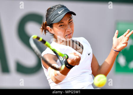 Paris, France. 23rd May, 2018. Lu Jiajing of China returns the ball to Margot Yerolymos of France during the women's singles Qualification 1st round match of French Open in Paris, France on May 23, 2018. Lu lost 0-2. Credit: Chen Yichen/Xinhua/Alamy Live News - Stock Photo