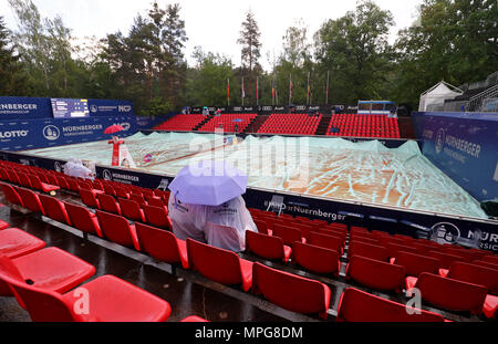 23 May 2018, Germany, Nuremberg: Tennis, WTA-Tour, women's singles. Two visitors sitting in the stands with rain ponchos and umbrellas during a rain interruption. Photo: Daniel Karmann/dpa - Stock Photo