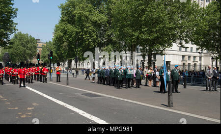 The Cenotaph, Whitehall, London, UK. 23 May, 2018. International Day of UN Peacekeepers Remembrance Ceremony is held at 1.30pm in Whitehall at The Cenotaph amidst tight security. The Band of the Irish Guards and the Colour Guard of the United Nations Veterans Association lead members of the diplomatic corps and other representatives invited by the United Nations Association UK, remembering those personnel who have died on UN Peacekeeping missions around the world since 1948. Credit: Malcolm Park/Alamy Live News. - Stock Photo