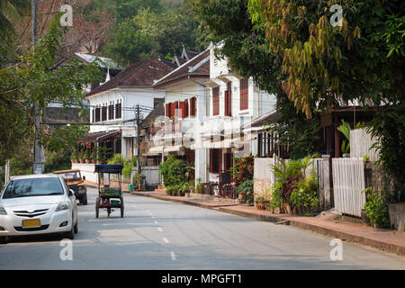 Quiet and idyllic Kingkitsarath Road in Luang Prabang, Laos, in the morning. - Stock Photo
