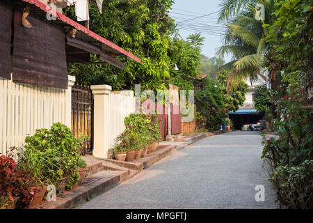 Idyllic side street in Luang Prabang, Laos, on a sunny day. - Stock Photo