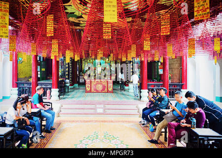 Hoi An, Vietnam - February 17, 2016: People in the temple in the old city of Hoi An, Vietnam - Stock Photo