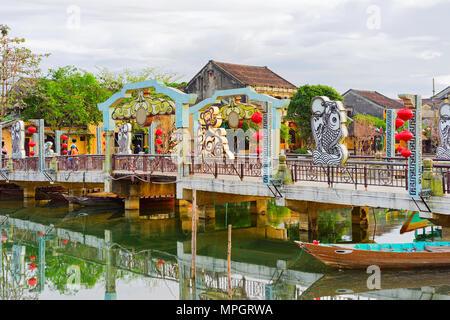 Hoi An, Vietnam - February 17, 2016: Boat near the Embankment of Thu Bon River, Hoi An, Vietnam - Stock Photo