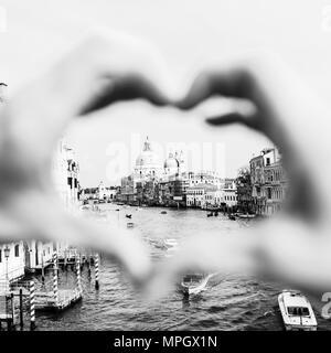 Santa maria della salute venice, italy framed by heart shaped hands - Stock Photo