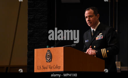 170228-N-RX668-151 NEWPORT, R.I. (Feb. 28, 2017) Cmdr. Ralph B. Shield, College of Naval Warfare's (CNW) Presidential Honor Graduate at U.S. Naval War College (NWC), speaks to students, staff, faculty and guests during his graduation ceremony at NWC in Newport, Rhode Island. Seventy-four students from the CNW and College of Naval Command and Staff were recognized for their achievements and received either a Master of Arts degree in National Security and Strategic Studies or Master of Arts degree in Defense and Strategic Studies during the ceremony.  (U.S. Navy photo by Mass Communication Speci - Stock Photo