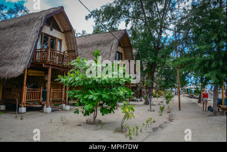 Bali, Indonesia - Apr 17, 2016. Summer cottages with garden near the beach in Bali Island, Indonesia. - Stock Photo
