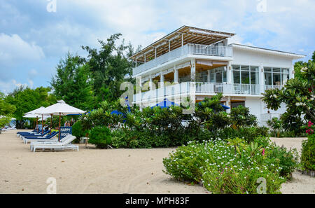 Lombok, Indonesia - Apr 17, 2016. Seaside hotel with the beach at sunny day in Lombok, Indonesia. - Stock Photo