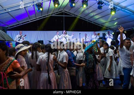 170314-N-SF984-114   MATARA, Sri Lanka (March 14, 2017) The U.S. 7th Fleet Band, Far East Edition, performs at Matara City Center as part of Pacific Partnership 2017. Pacific Partnership is the largest annual multilateral humanitarian assistance and disaster relief preparedness mission conducted in the Indo-Asia-Pacific and aims to enhance regional coordination in areas such as medical readiness and preparedness for manmade and natural disasters. (U.S. Navy photo by Mass Communication Specialist 2nd Class Chelsea Troy Milburn/Released) - Stock Photo