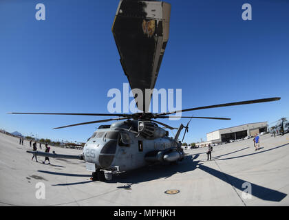 A U.S. Marine Corps CH-53E Super Stallion sits on the flightline at Naval Air Facility El Centro, California, March 11, 2017, during the 2017 NAF El Centro Airshow.  The CH-53 is the heaviest and largest helicopter used in the U.S. military, capable of carrying 16 tons of cargo or enough Marines for combat or humanitarian missions. (U.S. Air Force photo by Airman 1st Class Kirby Turbak/Released) - Stock Photo