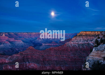 Night sky with full moon over Grand Canyon - Stock Photo