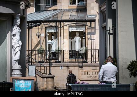 Caryatid and fashion shop in Montpellier, Cheltenham, Gloucestershire - Stock Photo