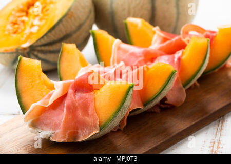 Cantaloupe melon with ham, a traditional Spanish and Italian appetizer - Stock Photo