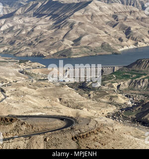 View of the dam of the Wadi Mujib reservoir from the land side, Jordan - Stock Photo