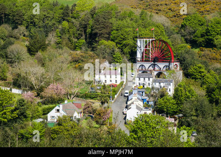 High view of Great Laxey Wheel and houses. Laxey, Isle of Man, British Isles - Stock Photo