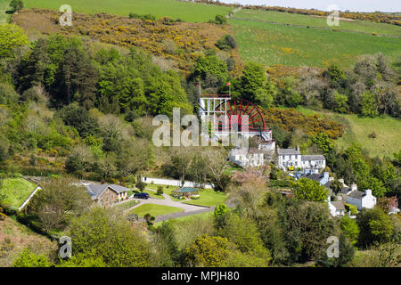 High view of Great Laxey Wheel, houses and countryside. Laxey, Isle of Man, British Isles - Stock Photo