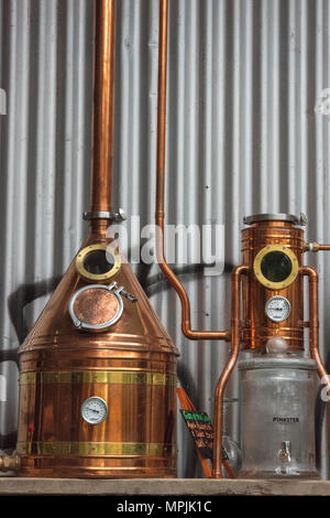 a copper whisky or gin spirits still at a micro brewery or distillery producing alcohol. Equipment used as a still for producing gins and whiskey home - Stock Photo