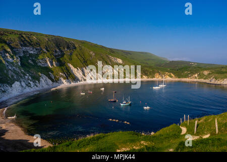Scenic view over Lulworth Cove, part of the Jurassic Coast UNESCO Natural World Heritage site in Dorset, England, UK - Stock Photo
