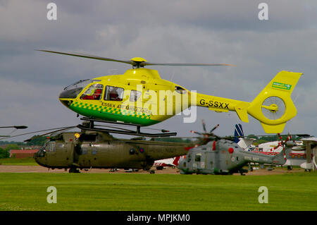 Essex Air Ambulance helicopter Eurocopter EC135 G-SSXX, landing at Southend airport during the airshow with Sea King and Lynx helicopters - Stock Photo