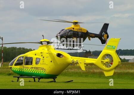 Essex Air Ambulance Eurocopter EC135 G-SSXX and Essex Police Eurocopter EC135 G-ESEX - Stock Photo