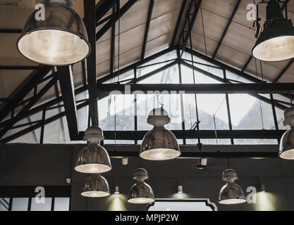 Hanging Vintage Steel  Lamps Decorated under The Roof in Loft Factory - Stock Photo