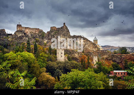 Old medieval castle Narikala at overcast cloudy sky at autumn time in Tbilisi, Georgia - Stock Photo