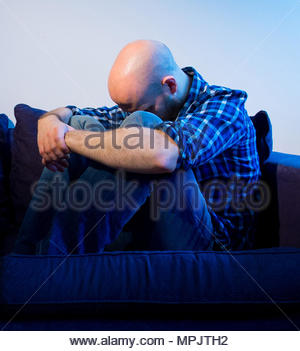 Embargoed to 0001 Thursday May 24 PICTURE POSED BY MODEL File photo dated 09/03/15 of a man sitting. Essential service providers are failing customers with mental health problems by offering limited and patchy support, Citizens Advice has claimed. - Stock Photo