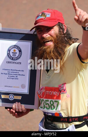 Club, charity and fancy dress runners after crossing the finish line in the 2018 Virgin Money London Marathon.  Featuring: atmosphere Where: London, United Kingdom When: 22 Apr 2018 Credit: John Rainford/WENN.com - Stock Photo