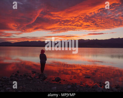 dreamer, silhouette of woman standing on the lake wooden pier at sunset, human strength, psychology concept - Stock Photo