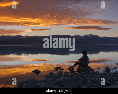 dreamer, silhouette of woman sitting on the lake wooden pier at sunset, human strength, psychology concept - Stock Photo