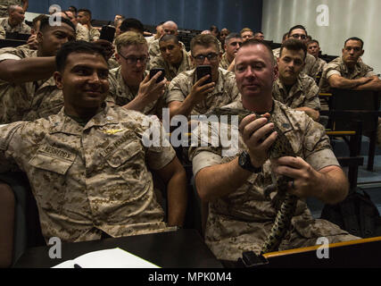 Marines apart of the Marine Rotational Force Darwin (MRF-D) Forward Coordination Element hold a saltwater crocodile at Rowell Centre on Robertson Barracks, Mar 17, 2017. Marines apart of MRF-D took classes to learn about the local wildlife in the Northern Territory of Australia. (U.S. Marine Corps photo by MCIPAC Combat Camera Lance Cpl. Damion Hatch Jr) - Stock Photo