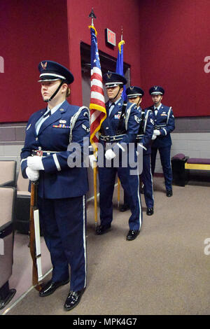 """--  An all-female Honor Guard team prepares to present the colors during the Robins Diversity Council's  """"Herstory"""" Women's History Month Panel at the Base Theater March 17, 2017. The purpose the event was to highlight some modern day, local """"Sheroes"""" that are at the top of their respective career ladders. Honor Guard members included: Staff Sgt. Katherine Dean, 16th Airbone Command & Control Squadron; Airman First Class Mckenzie Hinshaw, 461st Maintenance Group; Airman First Class Heather Schmidt, 51st Combat Communications Squadron; and Staff Sgt. Annzen Salvador, 78th Force Support Squadron - Stock Photo"""