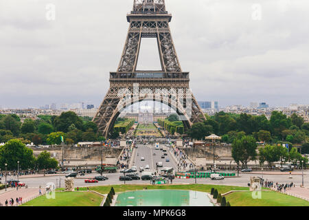 Paris, France July 24, 2017: Eiffel Tower close-up of a road with cars and buses traffic from a transporter, passage under an arch, a square for touri - Stock Photo