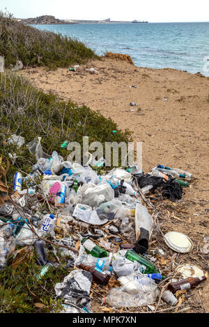 Pollution - Rubbish dumped on a beach in Cyprus. - Stock Photo