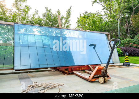 Stacked glass curtain wall at construction site - Stock Photo