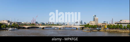 Panoramic view along the River Thames over Waterloo Bridge towards the iconic skyscrapers of the City of London, South Bank and Royal Festival Hall - Stock Photo