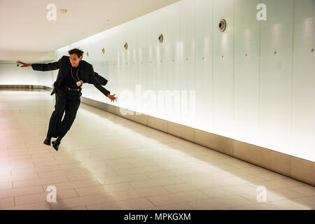 Montreal Canada RESO Underground City tunnel complex world's largest connects 60 buildings man jumps - Stock Photo
