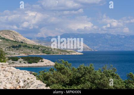A view of the coastline of the island of Krk near Stara Baska in Croatia - Stock Photo